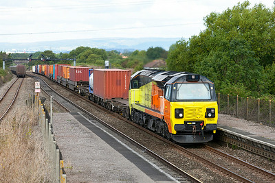 Colas Rail's 70803 on hire to Freightliner, heads through Pilning station with 4O51 09.58 Wentloog to Southampton MCT. Monday 18th August 2013.