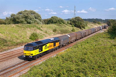 60087 'CLIC Sargent' drops downgrade to the Severn Tunnel at Pilning with 6V62 11.13 Tilbury Riverside to Llanwern empty steel carriers. Wednesday 6th August 2014.