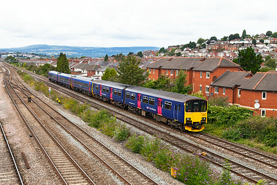 150131 & 158961 pass East Usk forming 1F13 11.08 Cardiff Central to Portsmouth Harbour. Sunday 24th August 2014.