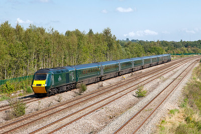 GWR's second green HST set with power cars 43005 & 43041 'Meningitis Trust Support for Life' rolls along the Up Slow at Church Road, Undy with 1L60 12.55 Cardiff Central to Paddington. Tuesday 30th August 2016.