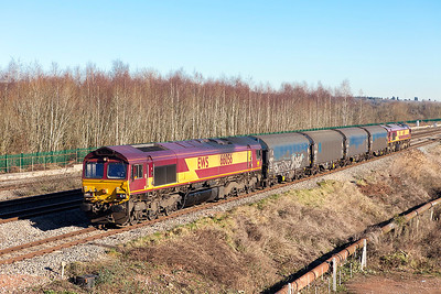 66056 & 66019 top & tail a short train of covered steel carriers forming a trip working to Llanwern Exchange sidings having reversed at Severn Tunnel Junction passing Church Road, Undy. Friday 20th January 2017. Would make an ideal short train for a model railway.