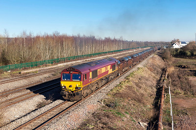 Having reversed at Severn Tunnel Junction 66130 powers past Church Road, Undy with 6M86 10.29 Margam to Dee Marsh loaded steel. 66077 'Benjamin Gimbert G.C.' is the rear loco. Friday 20th January 2017.
