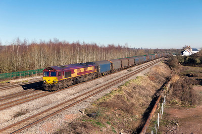 66092 passes Church Road, Undy with a lengthy 6V05 09.15 Round Oak to Margam empty steel carriers. Friday 20th January 2017.