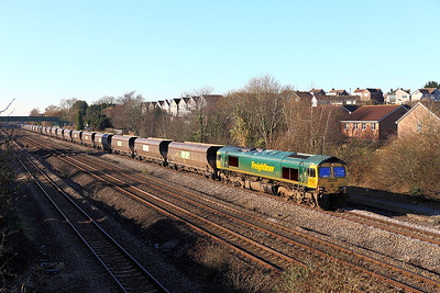 66507 passes Church Road, Undy with 4V20 06.35 Fiddlers Ferry Power Station to Stoke Gifford Yard empty coal hoppers. Friday 20th January 2017.