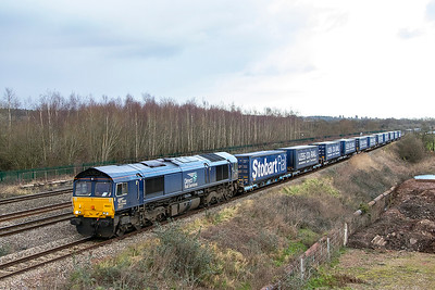 66431 heads along the Down Relief at Undy with 4V44 10.47 Daventry to Wentloog Tesco service. Thursday 25th January 2018.