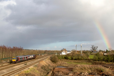 With a rainbow adding some colour to the scene, 170 104 heads towards Severn Tunnel Junction forming 1M98 14.45 Cardiff Central to Nottingham. Thursday 25th January 2018.