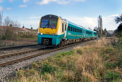 175 106 passes the site of Ponthir Station forming 1W60 11.03 Carmarthen to Manchester Piccadilly. Thursday 25th January 2018.
