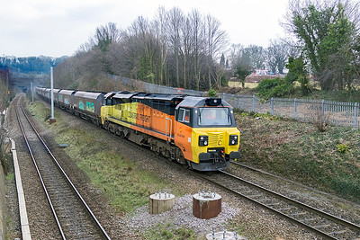 With the brake dust flying at the rear of the train 70812 slows for Pilning Loop passing Cattybrook with 6B22 14.29 Avonmouth to Aberthaw Power Staion loaded hoppers. Thursday 22nd February 2018.