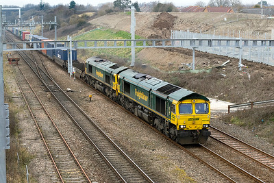 Oh dear the knitting cometh! 66596 with 66523 DIT climbs past Pilning village with 4O57 13.29 Wentloog to Southampton MCT Freightliner service. Thursday 22nd February 2018.