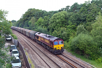 66061 heads 6O32 10.00 Margam to Dollands Moor loaded steel carriers past Ram Hill. Wednesday 9th July 2014.