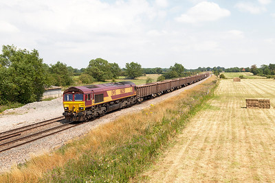 66250 passes Shrivenham with 6C48 13.30 Appleford Sidings to Whatley Quarry empty boxes. Wednesday 23rd July 2014.