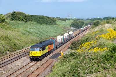 56113 climbs away from the Severn Tunnel past Pilning village with 6V54 05.35 Chirk Kronospan to Teigngrace empty log carriers. Wednesday 23rd July 2014.