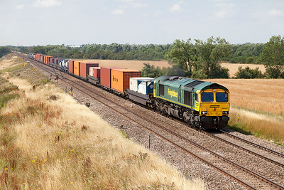 66587 passes Bourton with 4O51 10.58 Wentloog to Southampton MCT Freightliner service. Wednesday 23rd July 2014.