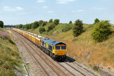 66743 passes Steppingstone Lane, Bourton with empty boxes forming 6M40 11.56 Westbury to Cliffe Hill Stud Farm. Wednesday 30th July 2014.