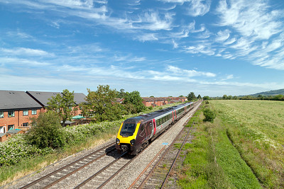 The 1V47 08.07 Manchester Piccadilly to Paignton passes Ashchurch Loop formed of 220024. Friday 13th June 2014.