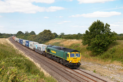 66570 passes Compton Beauchamp with 4L31 09.30 Bristol FLT to Felixstowe North FLT Freightliner service. Wednesday 30th July 2014.