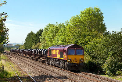 66039 passes Ashchurch with 6M96 05.51 Margam to Corby loaded coils. Friday 13th June 2014.