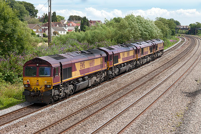 66136 drags 66122, 66105 & 66089 running as 0O12 11.06 Margam LIP to Eastleigh East Yard past Magor. Saturday 12th July 2014.