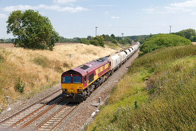 66128 passes Steppingstone Lane, Bourton with 6B35 10.47 Hayes & Harlington Tarmac Sidings to Moreton-on-Lugg empty stone hoppers. Wednesday 30th July 2014.