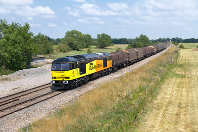 60087 'CLIC Sargent' passes Shrivenham with 6V62 11.13 Tilbury Riverside to Llanwern empty steel carriers. Shortly afterwards the train failed at Hullavington with loss of air on the loco. Wednesday 23rd July 2014.