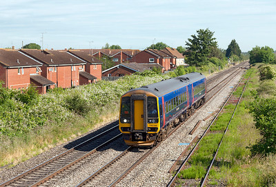 The 2F97 08.50 Great Malvern to Westbury slows for the Ashchurch stop formed of FGW's 158766. Friday 13th June 2014.