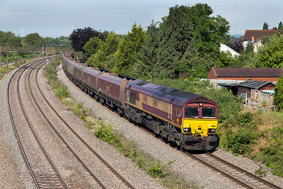 66156 passes Undy with 4F83 04.50 Aberthaw Power Station to Avonmouth empty hoppers. Saturday 12th Junly 2014.