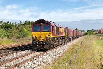 66102 passes Eckington with 4V83 05.19 Toton North Yard to Portbury Coal Terminal empty hoppers. Friday 13th JUne 2014.