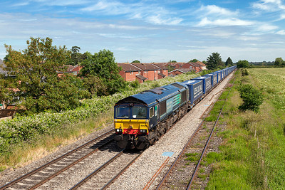 66424 passes Aschurch Loop in charge of 4V38 08.23 Daventry to Wentloog Tesco Express. Friday 13th June 2014.