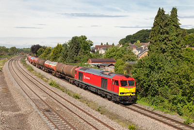 60044 has charge of 6B13 05.01 Robeston to Westerleigh loaded Murco tankers passing Undy. Saturday 12th Junly 2014.