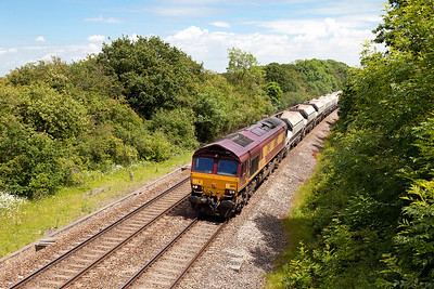 66182 passes Ram Hill with 4B35 10.47 Hayes & Harlington Tarmac Sidings to Moreton-on-Lugg empty stone hoppers. Friday 13th June 2014.