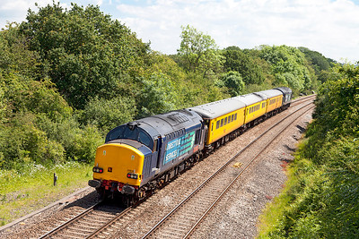 37607 top & tailed with 37610 'T.S. (Ted) Cassady 14.5.61-6.4.08) pass Ram Hill with 1Z04 12.13 Bristol Barton Hill to Hither Green test train. This going away shot shows the very high level of cant on this curve. Friday 13th June 2014.