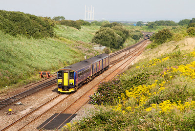 With the Second Severn Crossing in the background, 153372 & 150123 climb away from the Severn Tunnel forming 2C67 08.00 Cardiff Central to Paignton. Wednesday 23rd July 2014.
