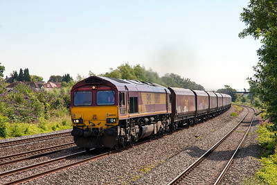 66050 'EWS Energy' passes Magor on the main with a late running 6B68 08.20 Avonmouth to Aberthaw Power station loaded hoppers. Saturday 12th Junly 2014.