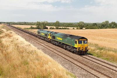 2 loco's 4 boxes. 66526 'Driver Steve Dunn (George)' with 66509 DIT passes Bourton with 4O24 11.00 Bristol FLT to Southampton MCT Freightliner service. Wednesday 23rd July 2014.