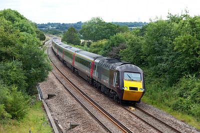 43321 leans to the curve approaching the site of Coalpit Heath station leading 1V50 06.06 Edinburgh to Plymouth Cross Country service with 43301 is the rear power car. Wednesday 9th July 2014.