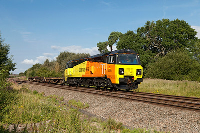 70810 has a very light load of 3 flats forming 6M50 07.55 Westbury to Bescot engineers service passing Shrivenham. Wednesday 30th July 2014.