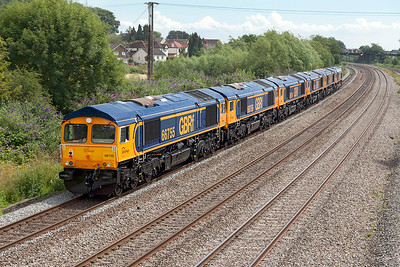 GBRF's newly delivered Class 66's 66752 'The Hoosier State', 66753, 66754, 66756 & 66755 are dragged past Magor by 66737 'Lesia' running as 0X66 12.00 Newport Docks to Doncaster Roberts Road. Saturday 12th July 2014.