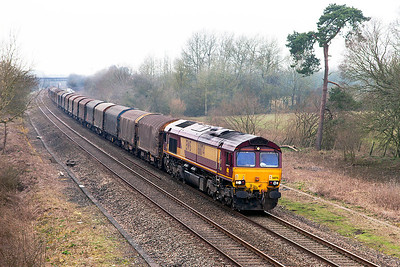 66174 passes Shrivenham eastbound with 6O62 10.00 Margam to Dollands Moor loaded steel carriers. Wednesday 12th March 2014.