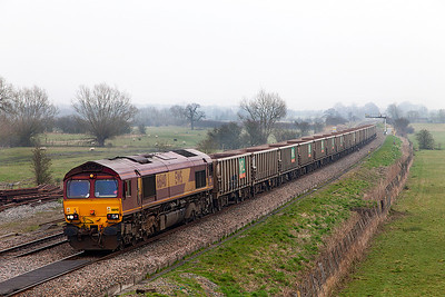 66140 passes Shrivenham in the gloom with 7C54 13.06 Oxford Banbury Road to Westbury empty stone wagons. Wednesday 12th March 2014.