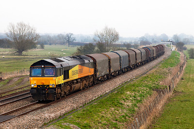 Once again the weather forecast was wrong. 66846 passes Shrivenham with 6V62 11.12 Tilbury Riverside to Llanwern empty steel carriers in very gloomy weather. Wednesday 12th March 2014.