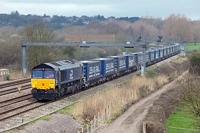 66425 passes Duffryn 53 minutes late due to an earlier loco failure, with 4V38 08.20 Daventry to Wentloog Tesco Intermodal service. Thursday 16th March 2017.