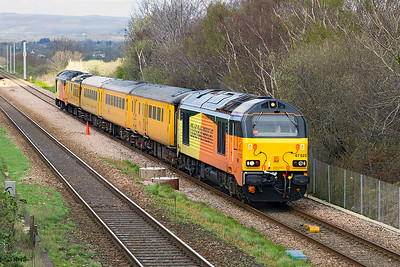 Colas 67023 leads 1Z20 05.07 Reading Triangle Sidings to Derby RTC via Swansea test train past Cattybrook on the climb away from the Severn Tunnel. 67027 is on the rear and stock consists of 9481, 977997, 72631 & 975091. Friday 31st March 2017.