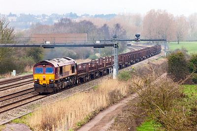 66002 heads the 6H24 11.20 Llanwern Exchange Sidings to Margam empty coil carriers passing Duffryn. Thursday 16th March 2017.