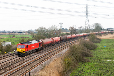 60091 'Barry Needham' passes Duffryn with 6B13 05.00 Robeston to Westerleigh loaded Murco Tanks. Thursday 16th March 2017.