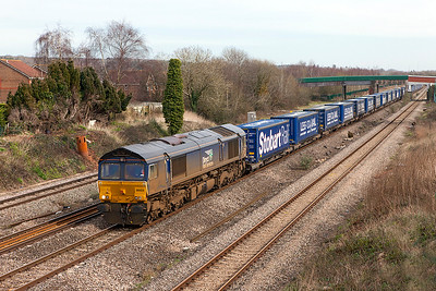 66423 heads the 4V38 08.20 Daventry to Wentloog Tesco service past Undy. Monday 6th March 2017.