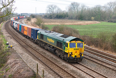 66533 'Hanjin Express' passes Duffryn with a well loaded 4O51 10.00 Wentloog to Southampton MCT Freightliner service. Thursday 16th March 2017.