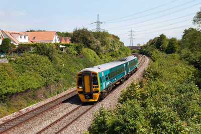 158822 passes Portskewett forming 2G55 11.59 Cheltenham Spa to Cardiff Central. Friday 16th May 2014.