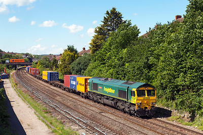 66534 'OOCL Express' passes Parson Street with 4L32 11.00 Bristol Freightliner Terminal to Tilbury. Wednesday 21st May 2014.