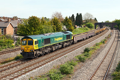 66597 'Viridor' brings up the rear of 6W17 11.00 Cardiff East to Westbury Yard spent ballast passing Undy. Sunday 4th May 2014.