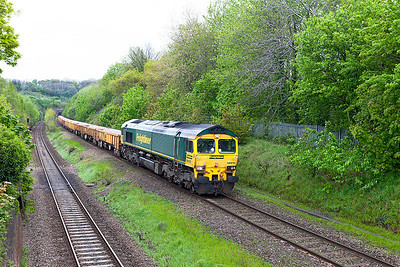 66515 emerges from Patchway Tunnel and passes Cattybrook with 6W08 09.57 Hinksey Yard to Rummney River Bridge loaded ballast. Friday 2nd May 2014.